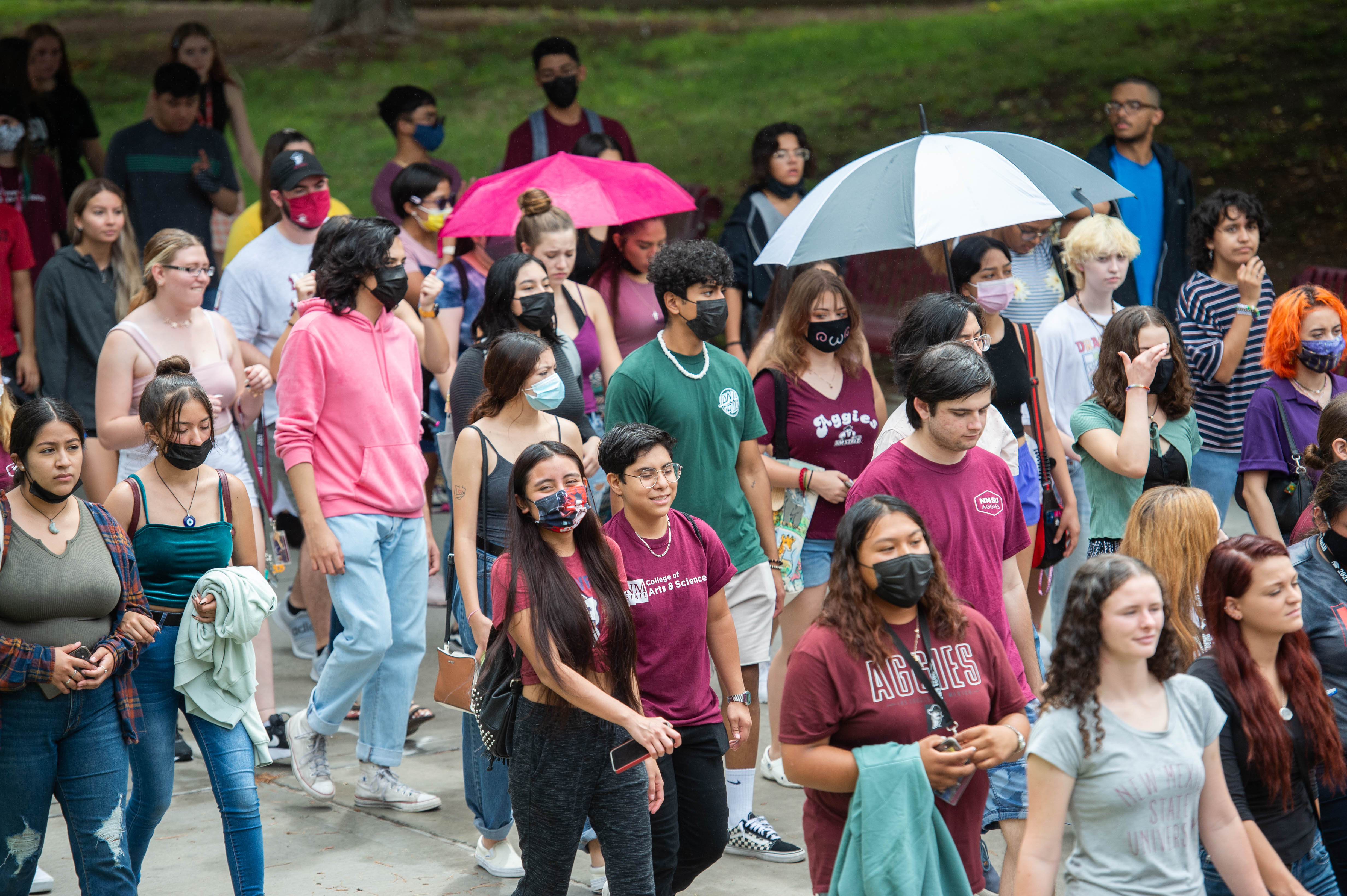 Crowd of students in masks walking